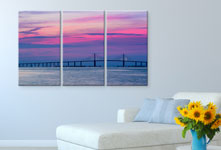 Drieluik met zonsondergang boven sofa